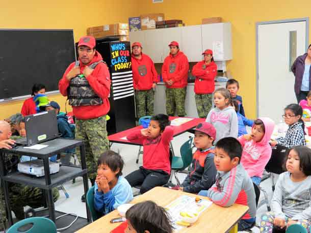 Students watch a PowerPoint presentation while Ranger Redfern Wesley talks about the importance of life jackets. Photo Sgt. Peter Moon