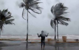 A man reacts in the winds and rain as Hurricane Irma slammed across islands in the northern Caribbean on Wednesday, in Luquillo, Puerto Rico September 6, 2017. REUTERS/Alvin Baez