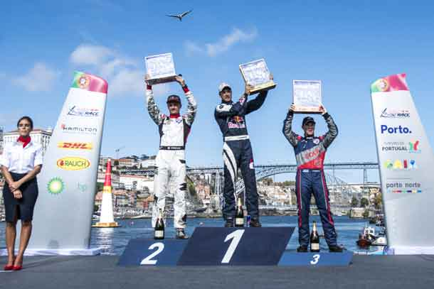 Martin Sonka of the Czech Republic (C) celebrates with Pete McLeod of Canada (L) and Matt Hall of Australia (R) during the Award Ceremony at the sixth round of the Red Bull Air Race World Championship in Porto, Portugal on September 3, 2017. // Mihai Stetcu/Red Bull Content Pool