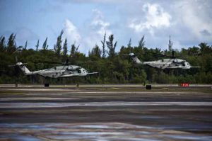 Marine Corps CH-53E Super Stallion helicopters lift off from the runway at Muñiz Air National Guard Base in Carolina, Puerto Rico, Sept. 18, 2017. The helicopters and crews are assigned to Joint Task Force Leeward Islands, U.S. Southern Command's primary response to Hurricane Irma. The aircraft were being relocated to Aguadilla, Puerto Rico, in preparation for Hurricane Maria. Marine Corps photo by Cpl. Melanie Kilcline