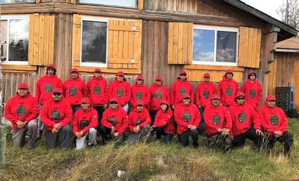 Nibinamik's new Canadian Rangers pose for a group picture.