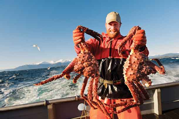 Alaska fisherman Kevin S. shows off his prized catch of wild, sustainable Alaska king crab, now in season along with Alaska snow and Dungeness crab.