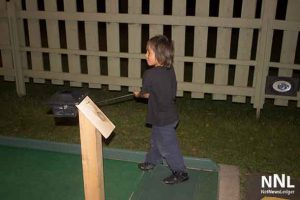 "Lamarith studies his ""Long Drive"" at the Mini Putt"