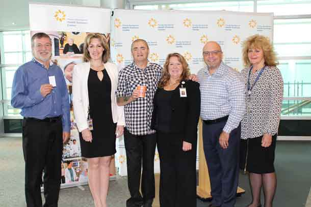A new patient discount program will help improve patient experiences by easing the financial burden that can often accompany a hospital stay. (From left to right: Phil Thompson, Manager of Material Distribution, Dr. Rhonda Crocker Ellacott, Executive Vice President of Patient Services, Keith Taylor, Co-Chair of the Patient Family Advisor Council, Bonnie Nicholas, Patient and Family Centred Care Lead, Claudio Foresta of Kelsey's Restaurant, Montana's BBQ and Bar and 5 Forks, and Mary Nucci, Contract Procurement Specialist)