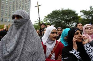 Women in traditional garb gather to protest against Quebec's proposed Charter of Values in Montreal, September 14, 2013. REUTERS/Christinne Muschi/File Photo