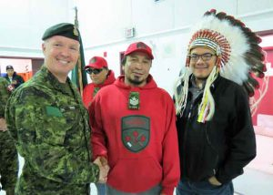 Brigadier-General Stephen Cadden, left, congratulates Sergeant Paul Oskineegish, centre, on become his patrol's new commander, along with Chief Johnny Yellowhead, right - Photo Sgt. Peter Moon