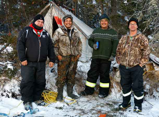 Missing trapper James Chapman, second from left, with his rescuers, from left, Sergeant Matthew Gull, Master Corporal Mike Koostachin, and Corporal Maurice Mack. Photo by Jason Hunter Canadian Ranger