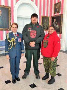 Governor General Julie Payette, left, with Junior Canadian Ranger Trevor McKay, and Master Corporal Karen Meeseetawageesic.
