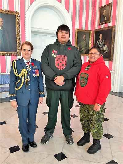 Governor General Julie Payette, left, with Junior Canadian Ranger Trevor McKay, and Master Corporal Karen Meeseetawageesic.