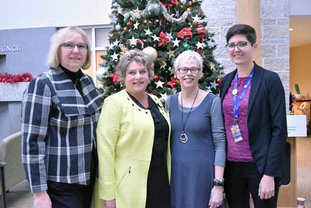 Celebrating the generosity of donors this giving season are (L-R): Jody Nesti, Chair, Board of Directors, Thunder Bay Regional Health Sciences Foundation; Lisa Beck, Director, Critical Care and Emergency Services, Thunder Bay Regional Health Sciences Centre; Pamela Peterson, Family member of patient who required emergency trauma care; and Lindsay Doran, e-Philanthropy Officer, Thunder Bay Regional Health Sciences Foundation. Donations are being gratefully accepted to fulfill the remaining items on the Health Sciences Foundation's Christmas Wish List to ensure patients and families have the gift of time together. Donors on Giving Tuesday already graciously raised $30,456 towards the total value of $83,881 for items on the Wish List, including fully funding 2 Bili Blankets.