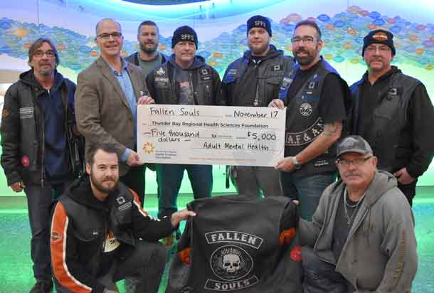 Members of the Fallen Souls Riding Association proudly present Dr. Peter Voros, Director of Forensic and Mental Health, with a cheque for $5,000.