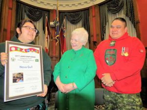 Junior Canadian Ranger Nova Gull of Peawanuck, received an Indigenous writing award yesterday from Ontario Lieutenant-Governor Elizabeth Dowdeswell, centre. Nova's father, Sergeant Matthew Gull of the Canadian Rangers, is at right. credit Sergeant Peter Moon, Canadian Rangers