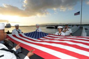 Members of the Joint Base Pearl Harbor Honor Guard fold the American flag during a double interment ceremony at the USS Utah Memorial during the 76th anniversary of the attacks on Pearl Harbor and Oahu at Joint Base Pearl Harbor-Hickam, Hawaii, Dec. 6, 2017. The 76th commemoration, co-hosted by the U.S. military, the National Park Service and the State of Hawaii, gave veterans, family members, service members and the community a chance to honor the sacrifices made by those who were present Dec. 7, 1941, and throughout the Pacific theater. Navy photo by Petty Officer 1st Class Randi Brown