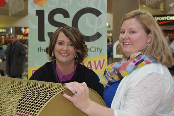 Stacey Ball, General Manager, Intercity Shopping Centre (left) pulls the winning ticket in the 18th annual Intercity Shopping Centre 50/50 Cash Draw. She is joined by Devon Sokoloski, Special Events Officer, Thunder Bay Regional Health Sciences Foundation.