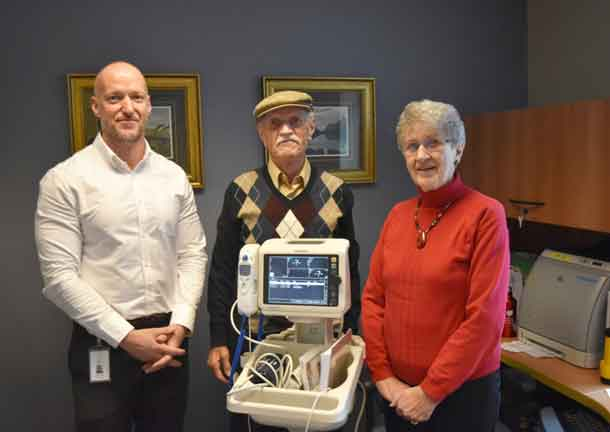 Wayne Taylor, Manager, In-patient Unit 2C with donors Mike and Helen Theodoropolous, who gave $5,000 to the Northern Cardiac Fund to support the purchase of a new Vital Signs Monitor for in-patient Unit 2C, which houses patients requiring acute cardiac or stroke care.