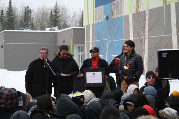 Greeting the people outside the school in Pikangikum