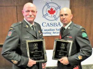 Chief Warrant Officer Robert Patterson, left, and Warrant Officer Carl Wolfe with special recognition awards for promoting boat and water safety in the First Nations of the Far North of Ontario.