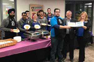 SUCCI and Confederation College are serving up to $30,000 in support of students to kick off this year's Stock the Bank campaign. Pictured in back are the SUCCI Board and volunteers who made pancakes and bacon to help launch the campaign. In front are (from left), SUCCI Administrator of Wellness and Diversity Thomas McDonald, Confederation College President Jim Madder and Confederation College Manager of Advancement and Alumni Services Dana Levanto.