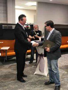 Copperfin CEO Dennis Alvestad accepts congratulations from Thunder Bay Councillor Frank Pullia