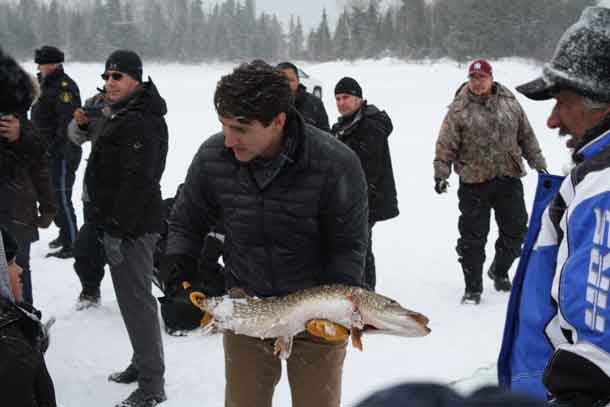 Prime Minister Trudeau with one of the Northern Pike caught in a gill net in Pikangikum during his visit