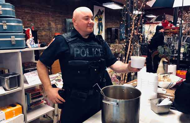 Serving up the delicious stew from Excuria an officer from the Thunder Bay Police Service engages with community