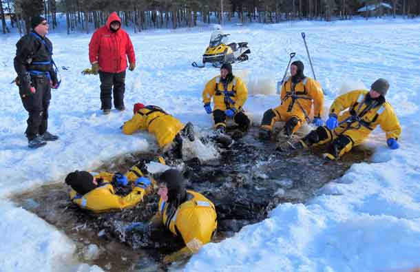 Rangers wear immersion suits while learning ice water rescue techniques. Photo by Sgt. Peter Moon