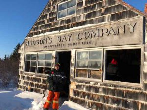 Junior Canadian Ranger Nova Gull in front of the abandoned Hudson's Bay Company trading post at Lake River in Polar Bear Provincial Park. credit: Canadian Rangers