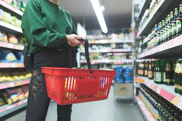 Shop with a carry basket to save in shopping - Image Depositphotos.com