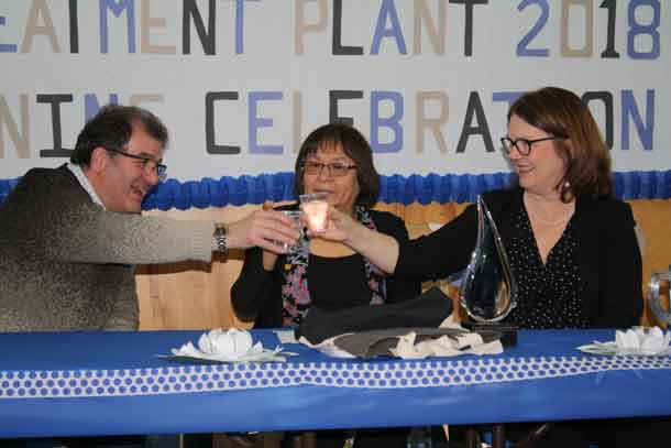 Kenora MP Bob Nault, Slate Falls Chief Lorraine Crane, and Minister of Indigenous Services Jane Philpott, cheers glasses of clean water during a celebratory luncheon at Bimaychikamah School in Slate Falls First Nation following the grand opening of the community's new water treatment plant on Tuesday, March 12, 2018.