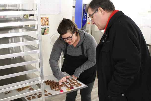 Alexis Pernsky, owner of Sweet, Lake of the Woods Chocolate, gives Kenora MP Bob Nault a tour of the business on Monday, Feb. 19, 2018.