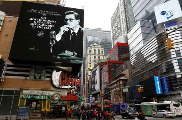 A billboard for late-night talk show host Stephen Colbert is seen near Times Square in the Manhattan borough of New York City. New York, U.S., January 16, 2018. REUTERS/Mike Segar