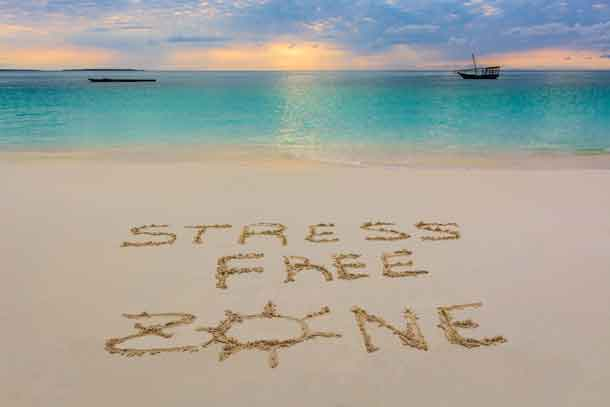i wrote this message in Nungwi beach in Zanzibar,Tanzania.This is paradice for no Stress! Image - deposit photos.com