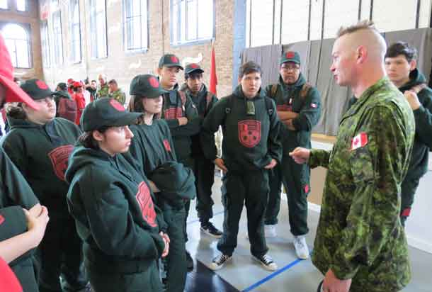 Warrant Officer Ron Wen talks with members of the Northern Ontario shooting team.