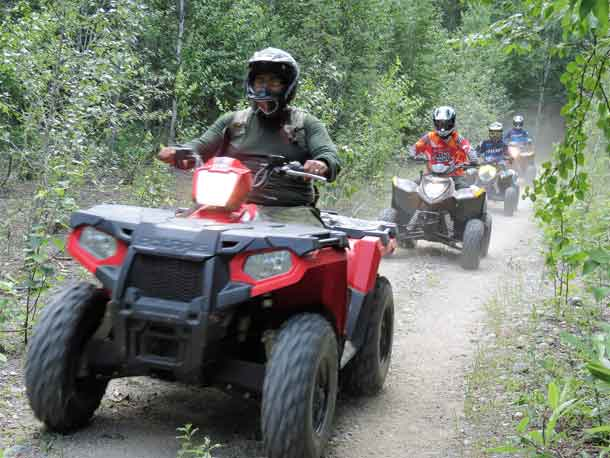 Junior Canadian Rangers end a day of training with a trail ride.