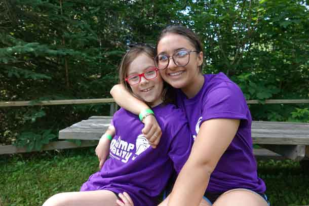Camper Lilly with volunteer Madison posing this morning for camp photos.
