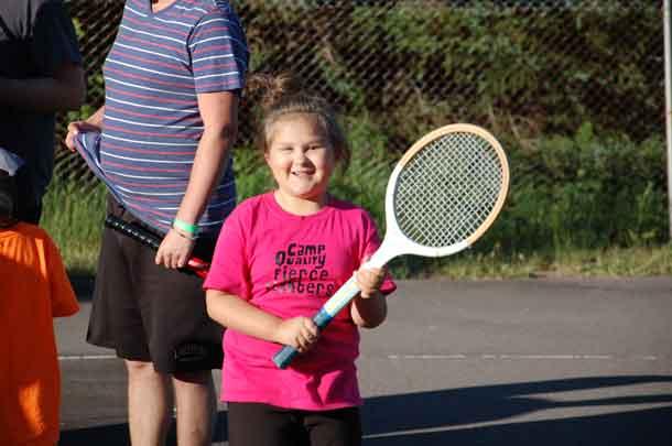 Camper Sam was having a blast playing tennis tonight. Go Sam go!