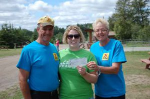 Camp director Ashleigh with Mike and Kristy from KOA, accepting their generous donation to our camp.