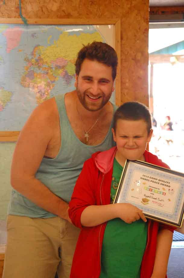 """Camper Ali showing off the """"Sweet Tooth"""" award he received from his companion Mehran."""