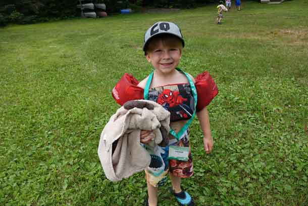 Camper Parker ready to dive into the lake with his fabulous swimming outfit.