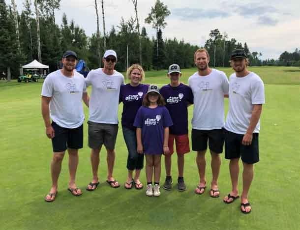 Director Ashleigh and campers Nevaya and Zeke with the Staal Brothers.