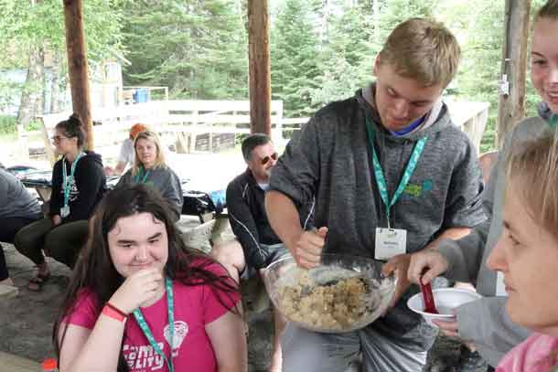 Campers Alyx, Braeden, and Katelyn mixing up a batch of cookies – YUM!