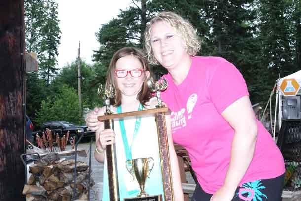 Camper Lillian receives the Quinten Spirit Memorial Award from Camp Director Ashleigh.