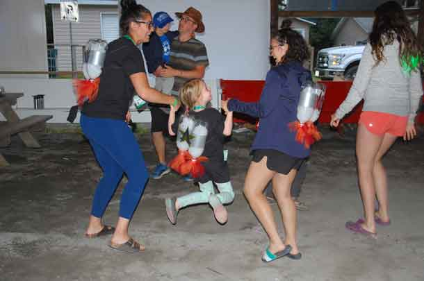 Camper Ally dancing the night away with volunteers Meaghan and Madison