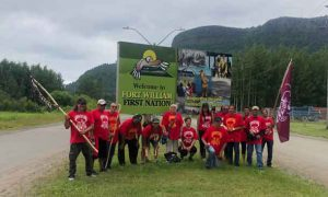 Spirit Walkers at the Fort William First Nation sign after crossing the James Street Bridge.