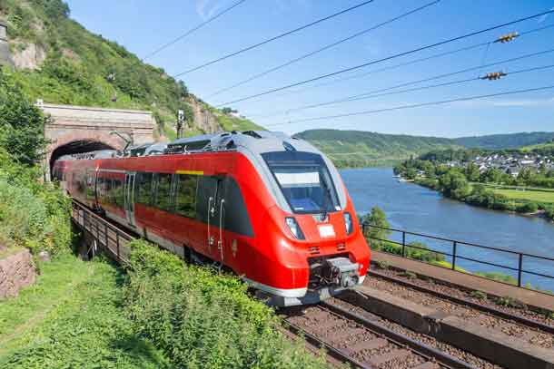 Intercity train leaving a tunnel near the river Moselle in Germany - Image Depositphotos.com