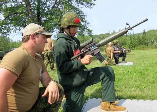 Junior Canadian Ranger Dylan Chisel prepares to shoot with an army C7 assault rifle, using non-lethal ammunition.