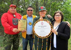 From left: Sergeant Matthew Gull, Grand Chief Alvin Fiddler, Junior Canadian Ranger Nova Gull, and Catherine Gull. Credit Sergeant Peter Moon, Canadian Rangers