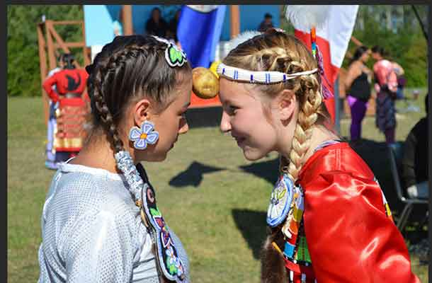 Jingle Dress Dancers from Mattagami FN taking part in a Pow Wow contest at the Eighth Annual Mattagami FN Pow Wow are L-R: Calee Boissoneau Hunter and Tessa Thomas.