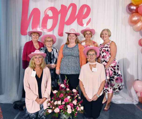The Tbaytel Luncheon of Hope Committee (back, L-R) Barb Midgley, Deb Saunders, Devon Sokoloski from the Health Sciences Foundation, Barb Sanderson, (front) Lynn Tapak, and Sue Childs, pictured here with 7-year emcee Katie Crowe (far right).