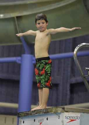 Thunder Bay Diving Club - Walker a local youth on the diving board
